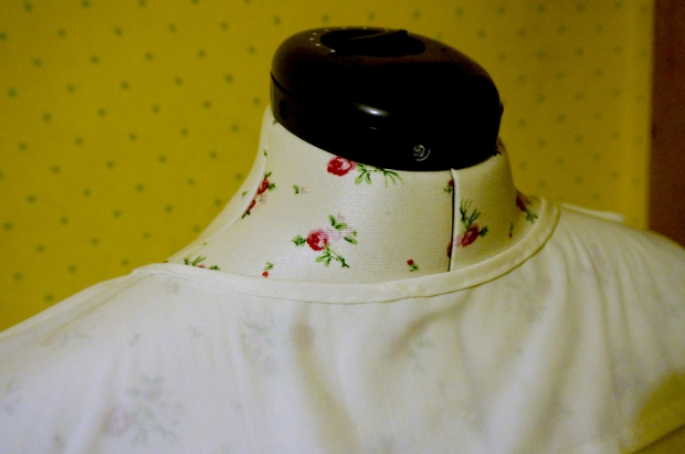 The bias tape, sewn and blind-stitched to the inside of the neckline